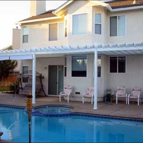 White Awning over Concrete Pool Area