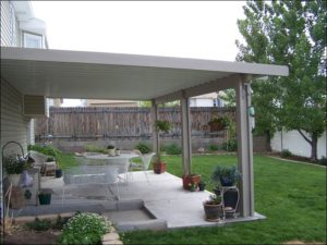 Backyard Patio with White Patio Cover sideview