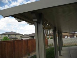 Patio Covering with Small Lantern Covering Concrete