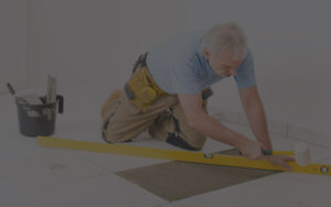 Man Laying Down White Tile