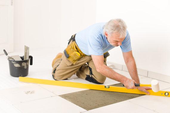 Man Laying Down Tile
